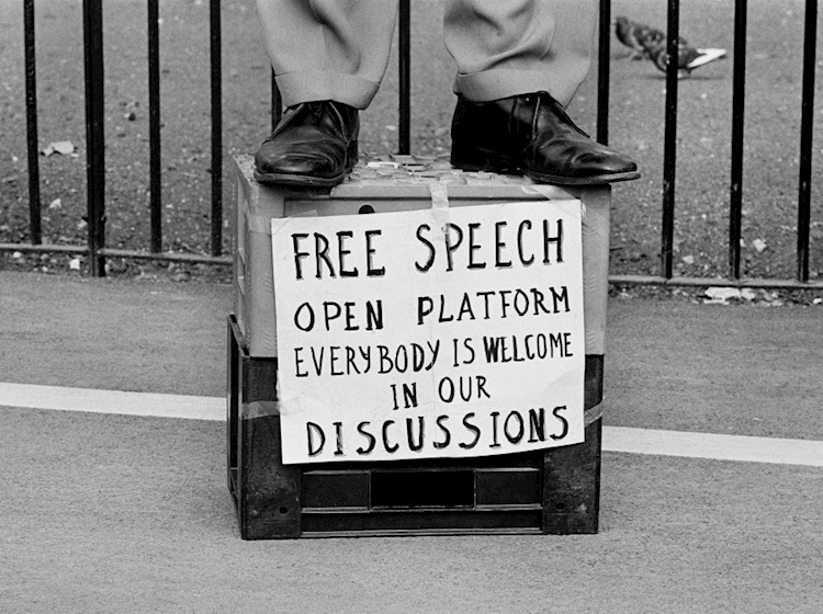 man_standing_on_a_diy_podium_advocating_free_speech