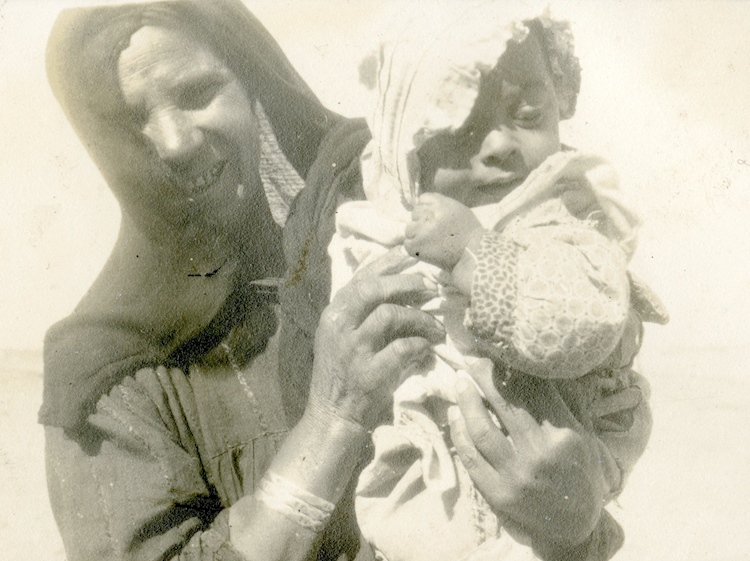 an_egyptian_woman_with_her_baby