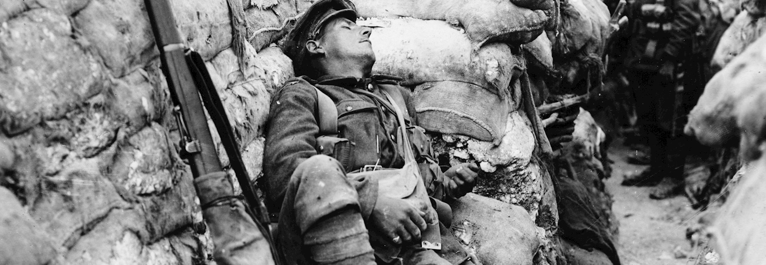 a_young_soldier_sleeping_in_the_trenches