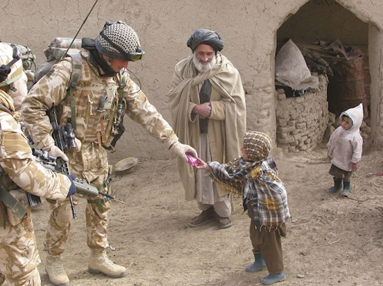 lt_connolly_giving_ration_biscuits_in_kandahar