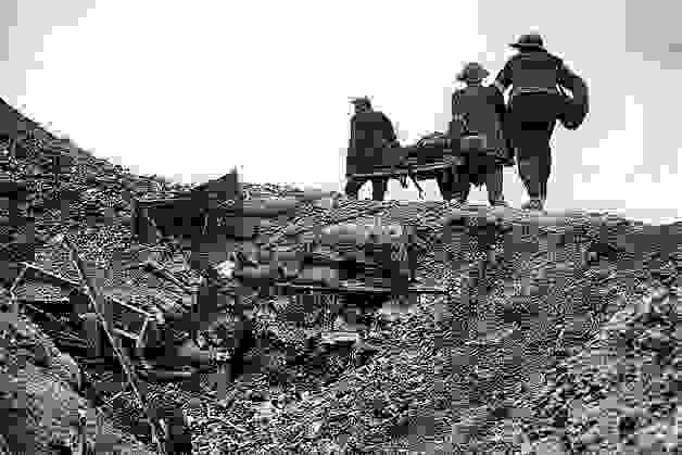 stretcher_bearers_move_over_open_ground_to_rescue_a_fallen_commrade_battle_story_somme_1916