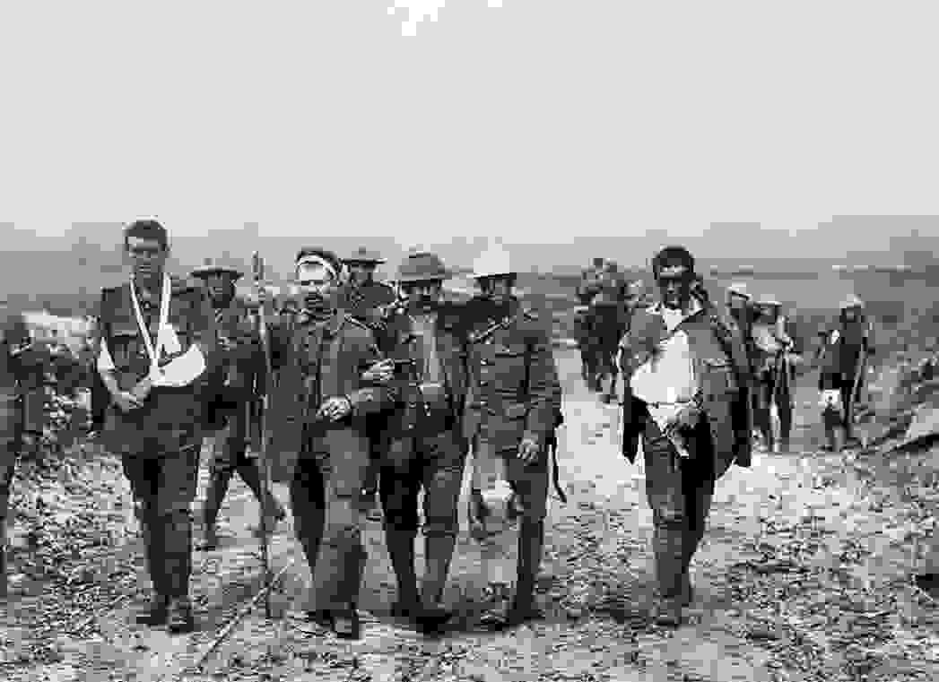 wounded_british_and_german_troops_walking_near_bernafay_wood_19_july_1916_battle_story_somme_1916