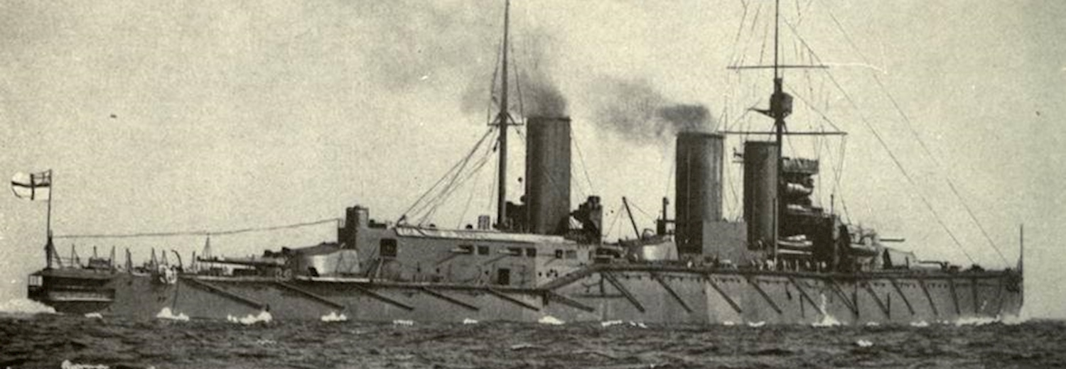 hms_queen_mary_at_sea_with_torpedo_net_booms_folded_against_her_side