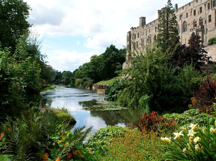 warwick_castle_viewed_from_the_mill_garden