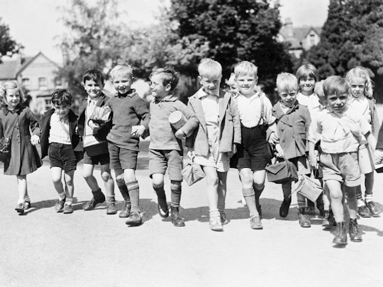 a_group_of_evacuees_from_rotherhithe_in_kent_with_gas_mask_boxes_on_a_walk_in_reading_1940