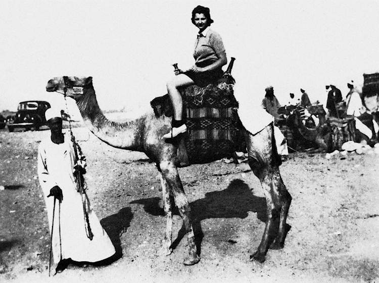 wren_sheila_mills_on_a_camel_in_egypt_near_the_pyramids