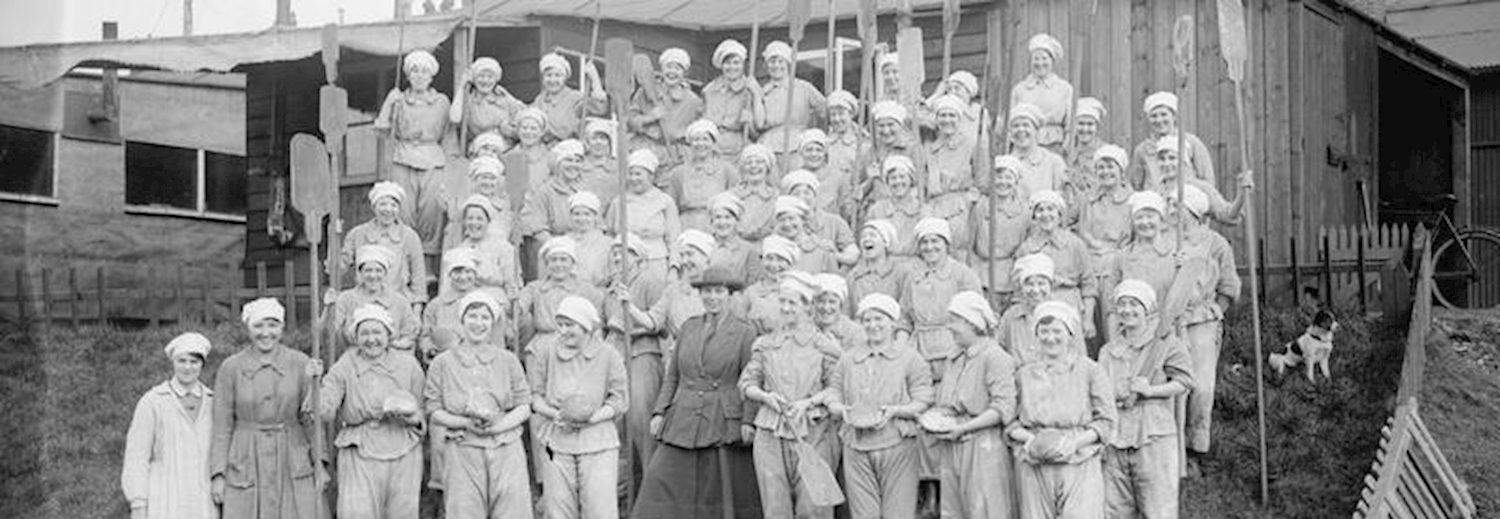 members_of_the_womens_army_auxiliary_corps_pose_for_a_semi_formal_group_portrait_at_the_british_army_bakery_at_dieppe_france_on_10_february_1918