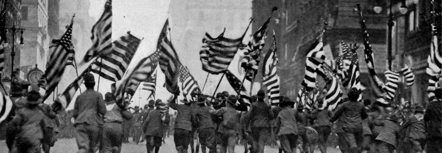 boy_scouts_charging_down_fifth_avenue_new_york_with_flags_flying_on_april_19_1917_in_the_wake_up_america_parade