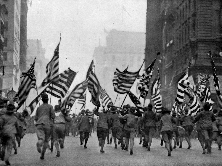boy_scouts_charging_down_fifth_avenue_new_york_with_flags_flying_april_19_1917_in_the_wake_up_america_parade