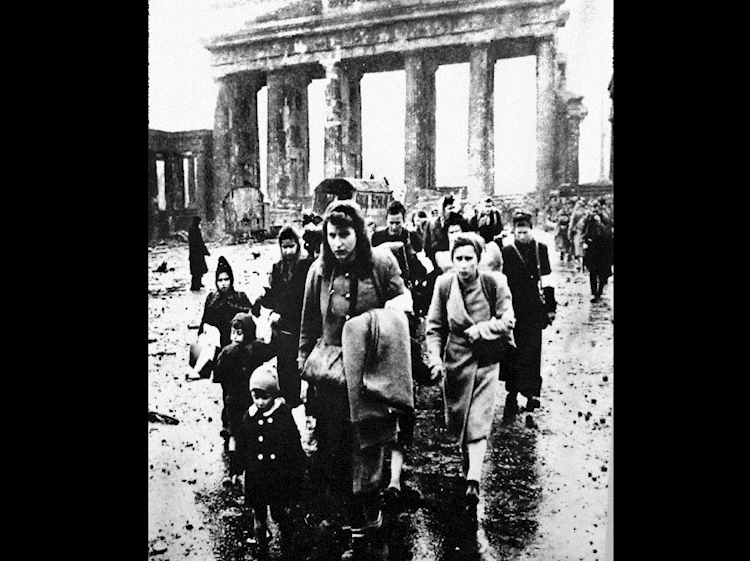 many_women_and_children_walked_hundreds_of_miles_to_return_to__the_ruined_city_of_berlin
