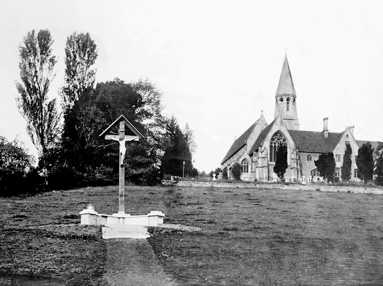 woodchester_wayside_cross_with_church_behind