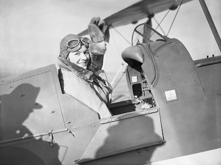 pauline_gower-_commandant_of_the_air_transport_auxiliary_womens_section-_waving_from_the_cockpit_of_a_de_havilland_tiger_moth_at_hatfield-_hertfordshire