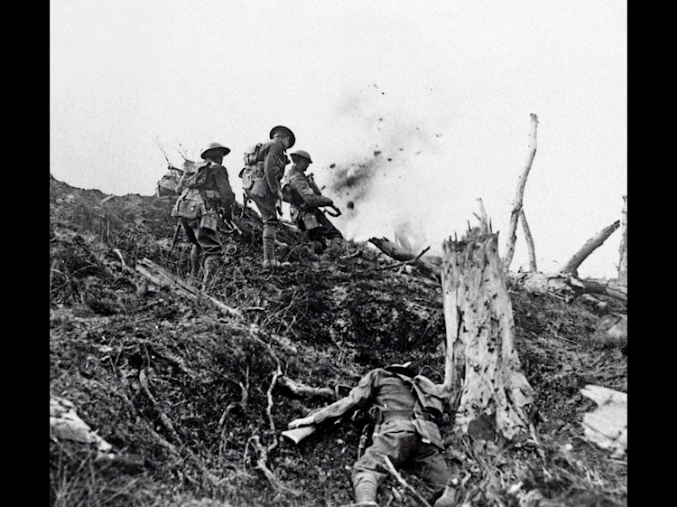 british_troops_advance_across_no-man-s-land-_with_no_choice_but_to_pass_a_casualty_by