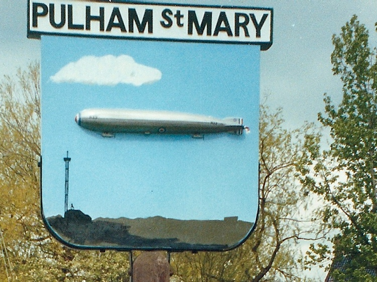 the_village_sign_at_pulham_st_mary_norfolk_depicting_the_r33_airship