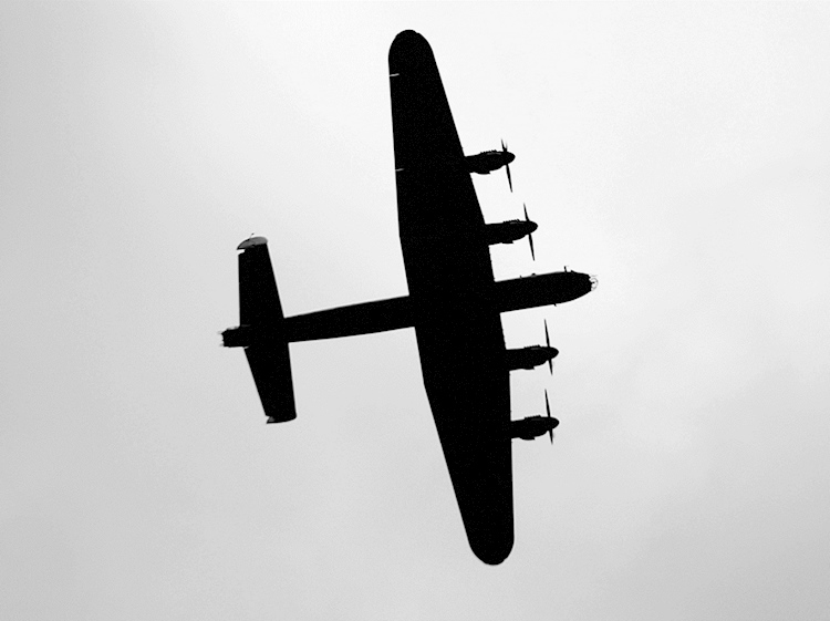 a_lancaster_bomber_during_the_royal_fly_past-_june_2013