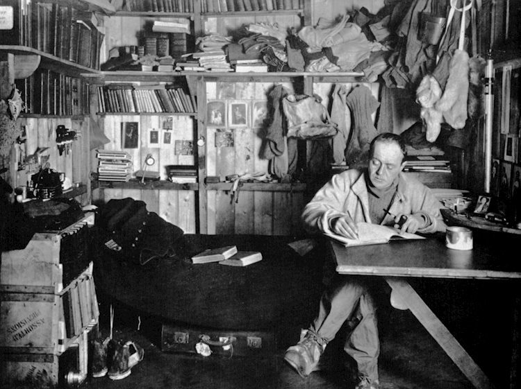 robert_falcon_scott_writing_in_his_diary_in_the_cape_evans_hut_october_1911-1